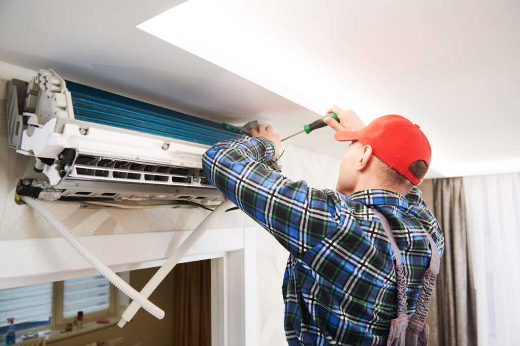 aircond technician cleaning house air conditioning unit