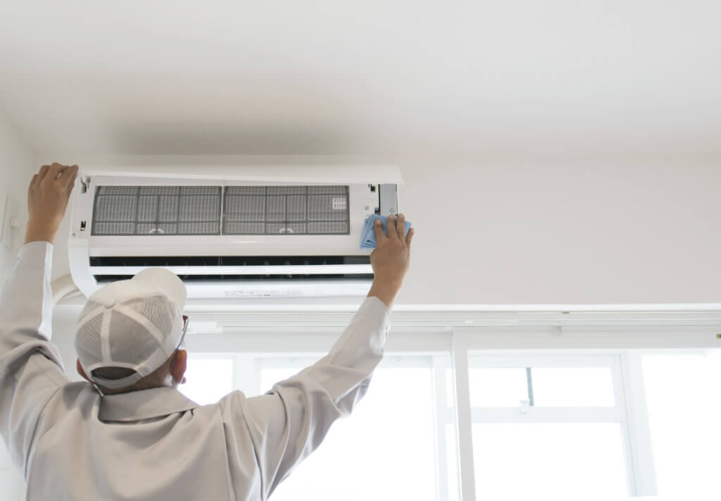 uncle installing aircon