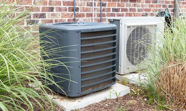 air-conditioner-should-be-installed-away-from-shrubs-and-plantations
