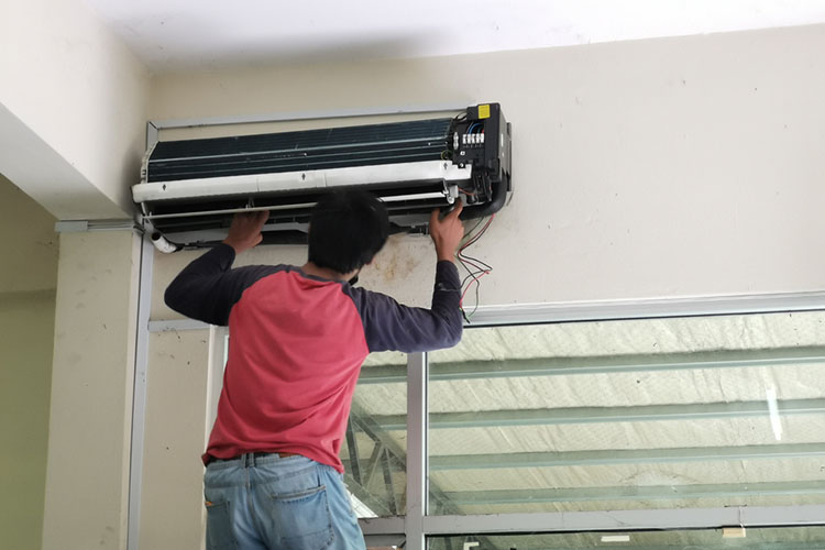 our technician installing air conditioner for a home owner in kuala lumpur